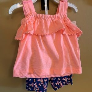 NWT. Carters pink tank top with blue shorts.
